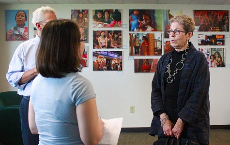 Kay Chernush talks to students and faculty about her photographs of human trafficking across borders.