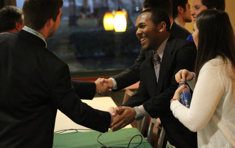 President-elect Keith Taylor, Jr. shakes hands with JUSA candidates after the Feb. 10 debate.