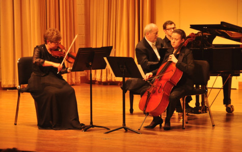 "Scott Watkins, piano, Marguerite Richardson, violin, and Shannon Lockwood, cello, perform ""Trout"" Quintet in Terry Concert Hall."