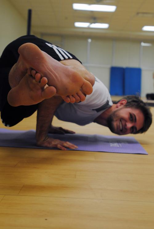 Robert Bemman, sophomore excercise science major, stretches before leading his afternoon yoga class.