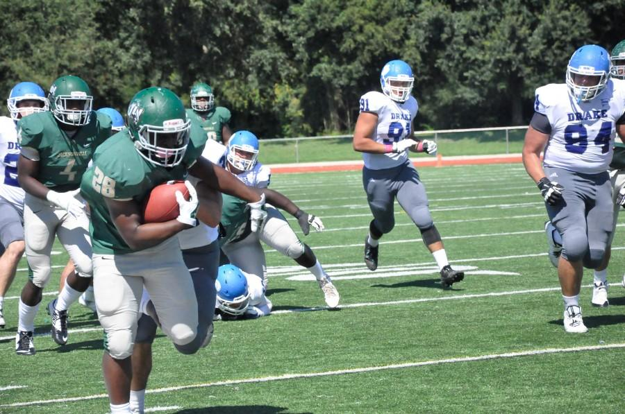 Running back Ulysses Bryant, 28, scores a touchdown.