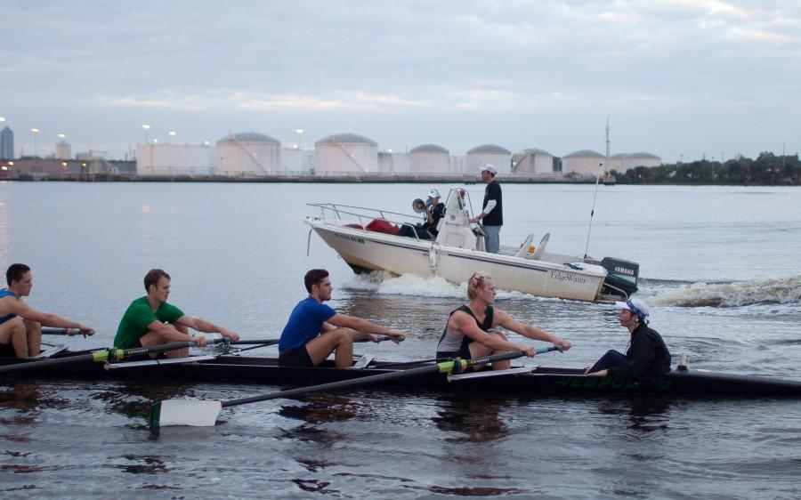At+an+early+morning+practice+Oct.+4%2C+Coach+Marci+Robles+gives+direction+from+a+megaphone+as+the+team+rows+past+her+and+Assistant+Coach+Rich+Kelley+in+the+coaching+launch.+