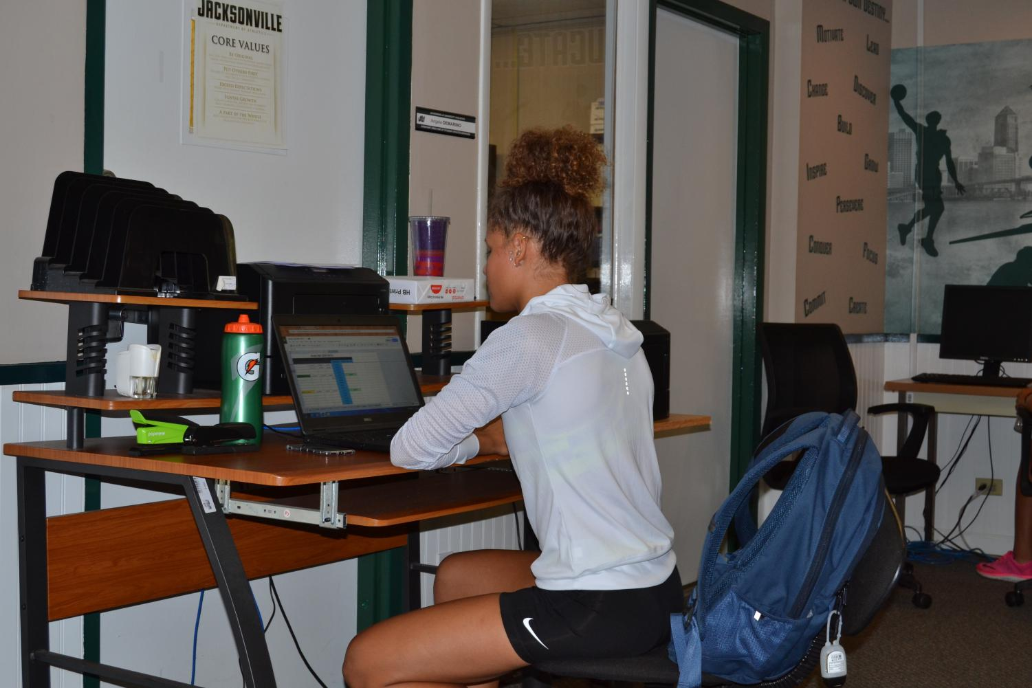 JU track and field athlete, Lyric Schmalz, doing homework in the Student-Athlete Center for Success located in Botts Hall.