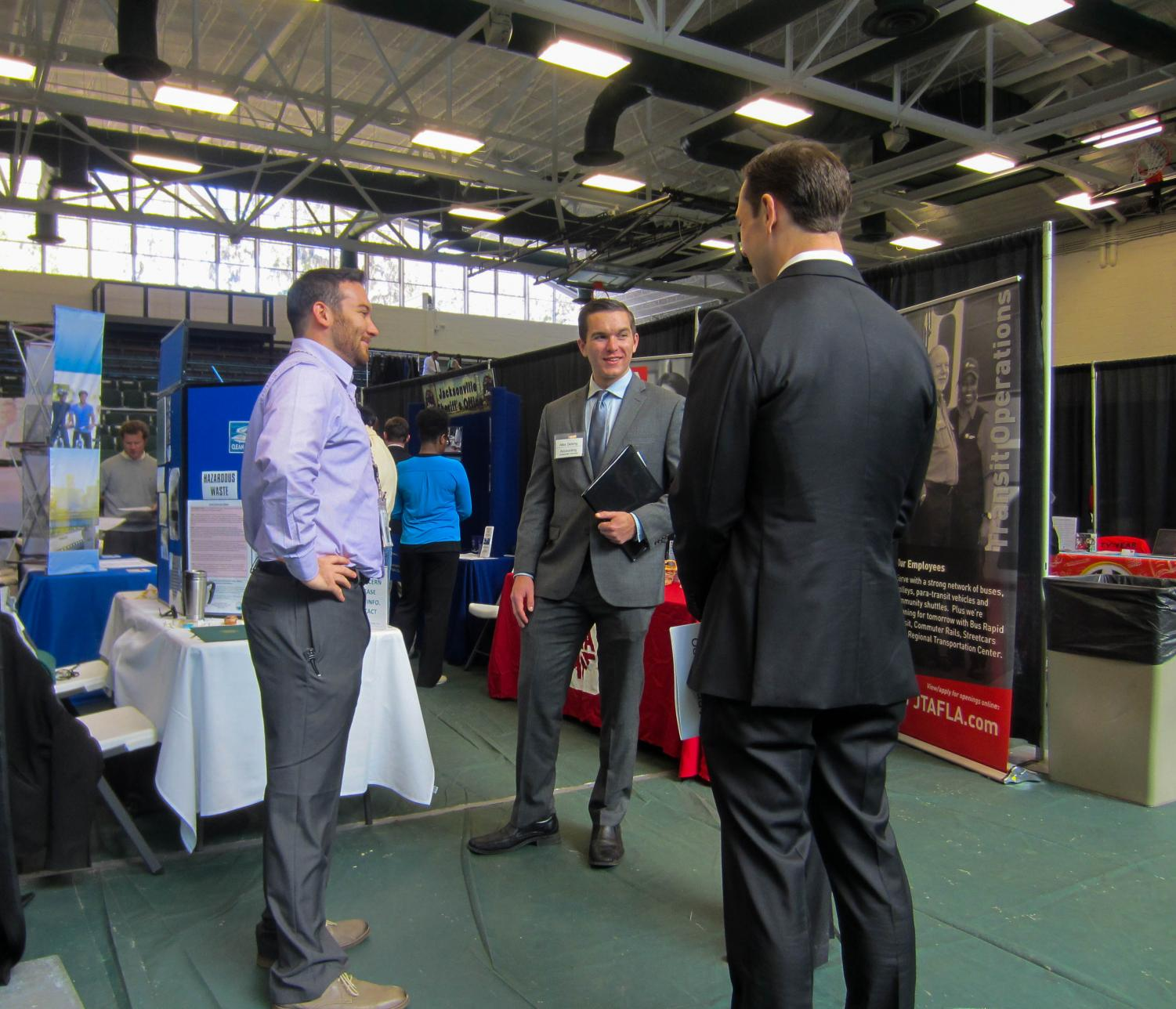 JU students Alex Delong and Pierce Klinic at the Career Expo hosted at the Swisher Gymnasium on Spring 2017.