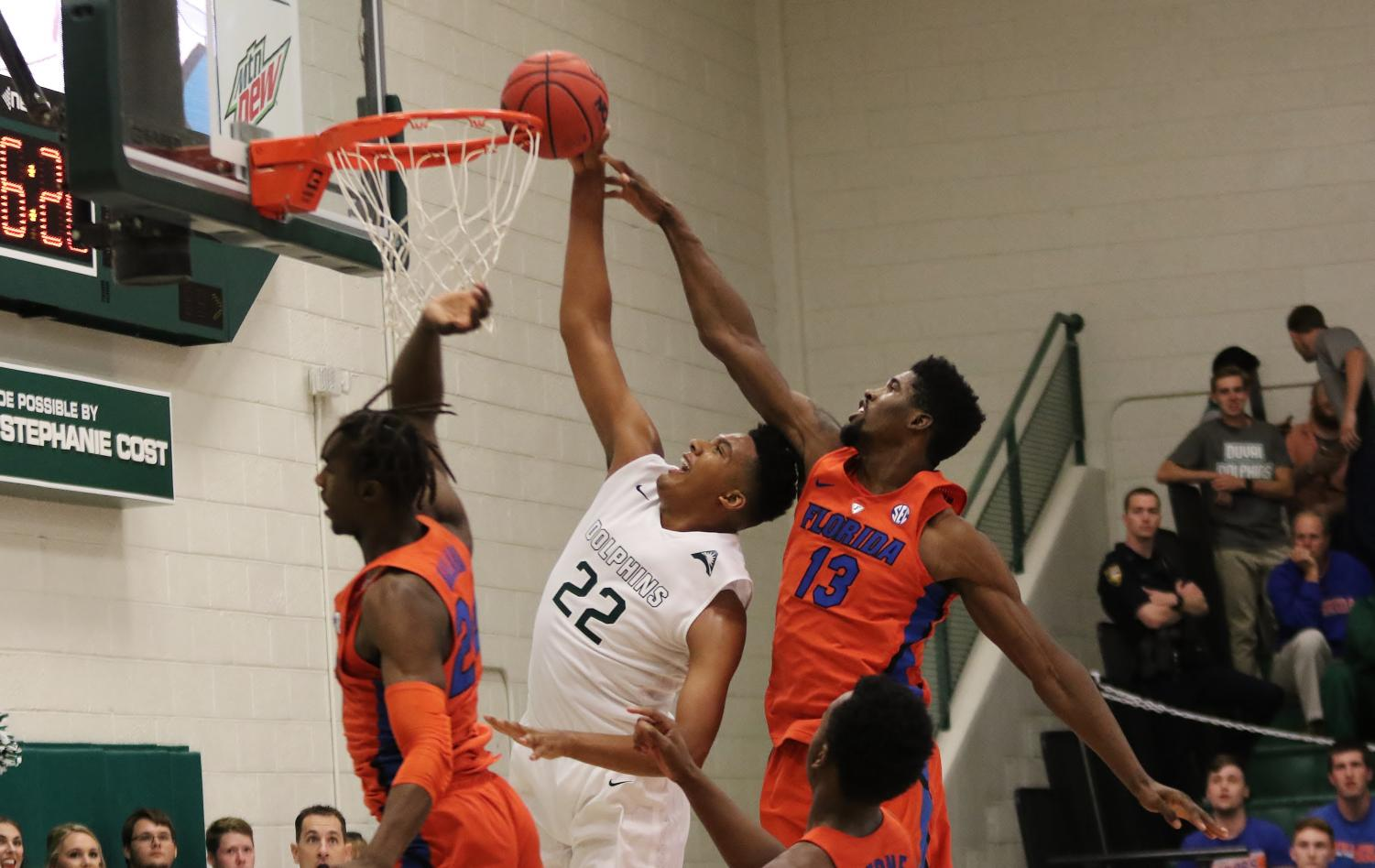 JU basketball player number 22, Radian Bakkali, going up to dunk the back during their recent game against the University of Florida.