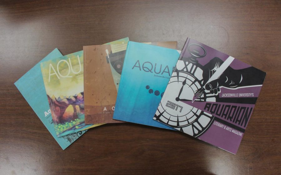 Past issues of the Aquarian are displayed for readers.