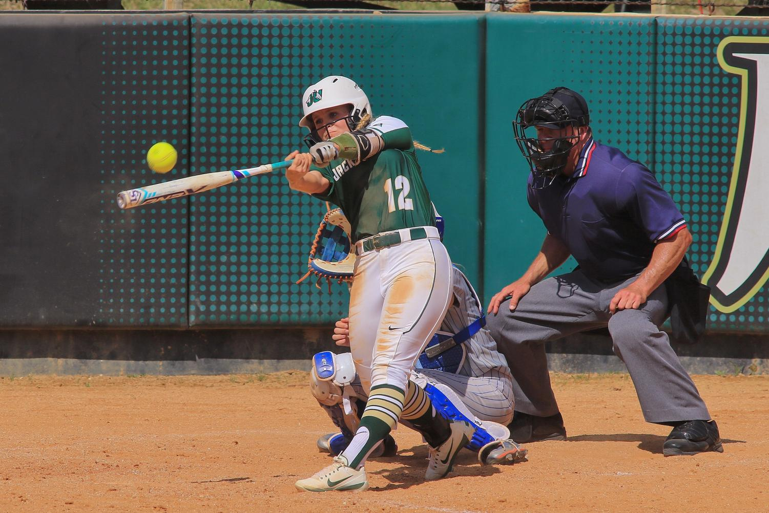 Allie McCourt swings at home base against the University of Tennessee Arlington. The Dolphins won 3-1.