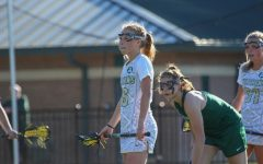 Senior Ashtyn Hiron concentrates during a lacrosse game.