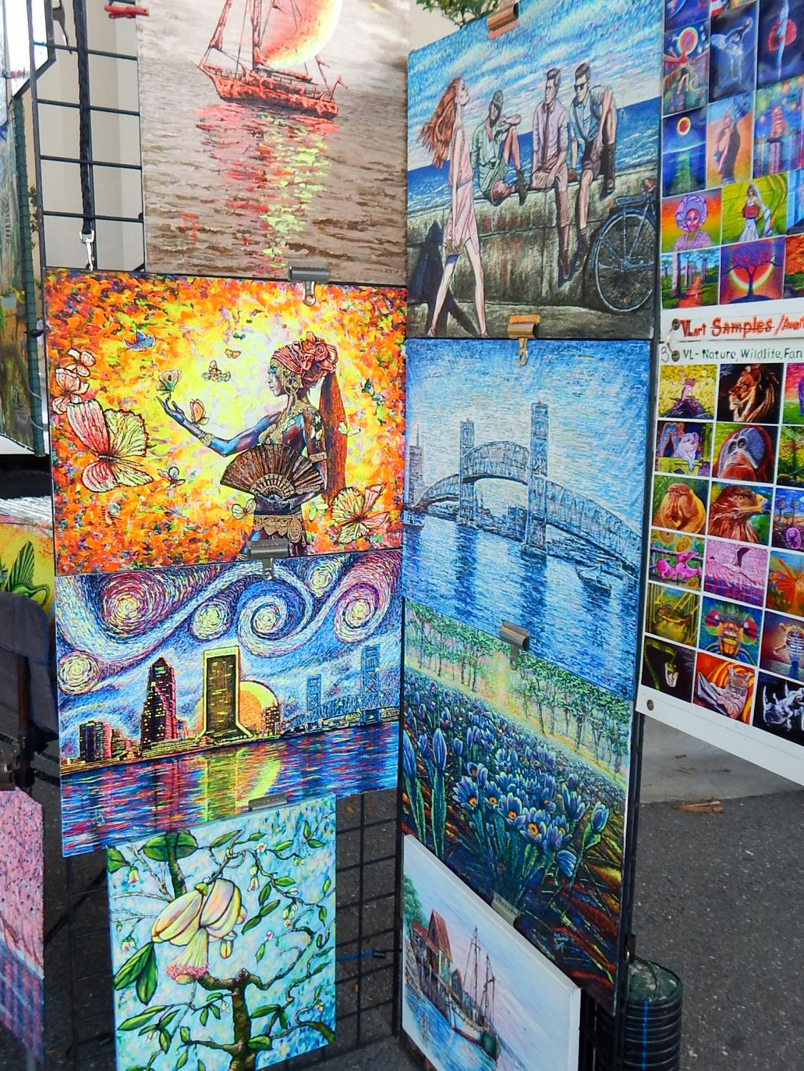 Paintings are displayed to be sold at the market.