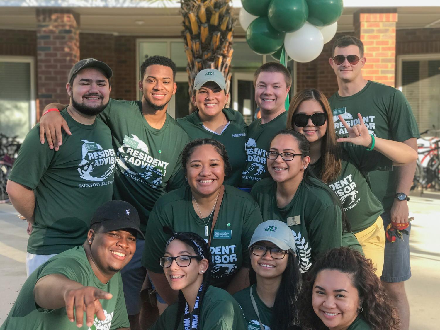From left to right, RAs Sam Ayala, Richard Tyler, Professional Staff member Kelsey Parker, Kasey Williams, Ruda Less, and Ryan Noles. In the middle row, from left to right, Lasiana Nunu & Professional Staff member Melissa Alberto. Lastly, in the bottom row, from left to right, Marcus Shields, Maggie Ruiz, Reggie Lynn Agulto and Angie Acedera.