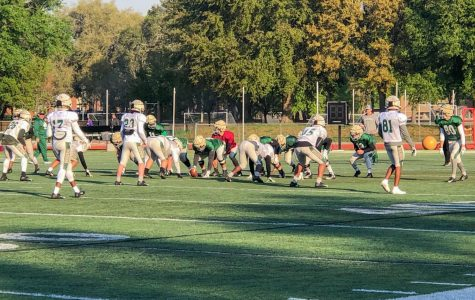 The Jacksonville University football team sets up a play during practice for the scrimmage taking place on March 30.
