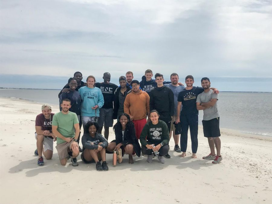 Ngog Nliba Nguimbous, back left, with other students from University of North Florida on Mexico Beach.