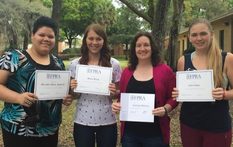 Barclay displays FPRA awards with fellow students.