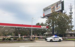 Police mark off the Gate gas station hours after the Dec. 15 shooting.