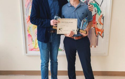 Patrick Farrell and Michael Csorba display their awards for their short film 'A Happy Smile.'