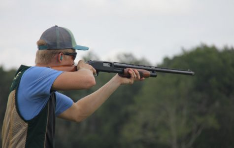 Harrison Carew aiming down the sights.