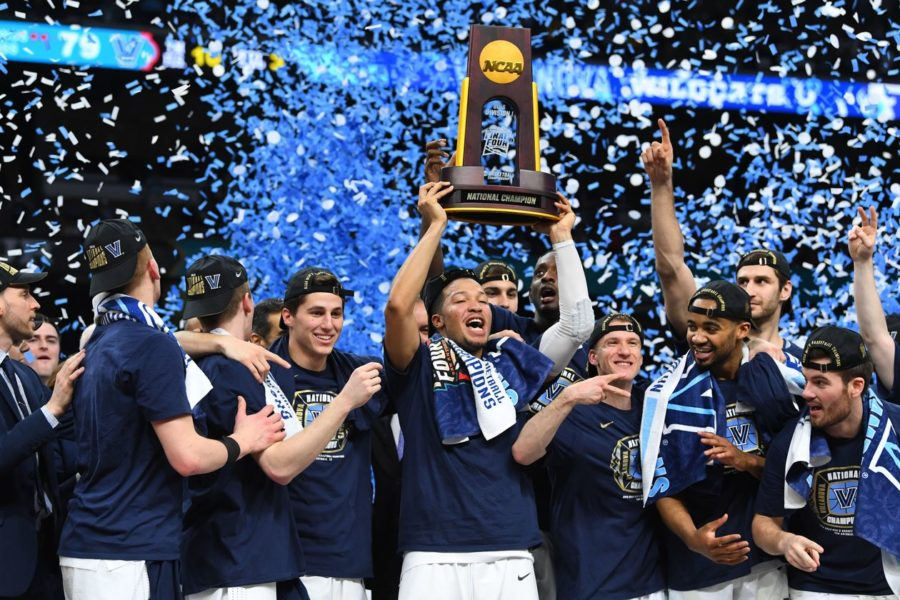 Villanova+Wildcats+guard+Jalen+Brunson+hoists+the+national+championship+trophy+after+defeating+the+Michigan+Wolverines.