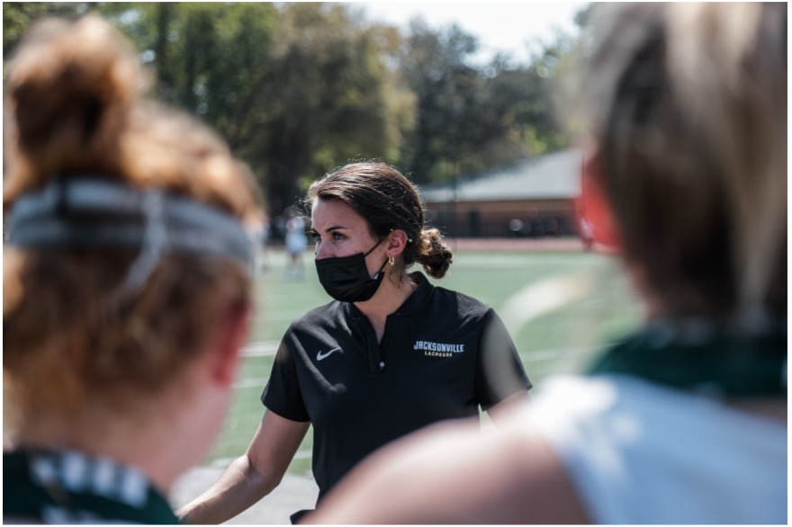 Associate+Head+Coach+Britt+Orashen+talking+to+her+players+at+University+of+Florida+game.+Photo+Courtesy+of+Women%E2%80%99s+Lacrosse+Athletic+Department.+